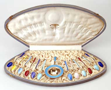 Box of silver and enamel spoons